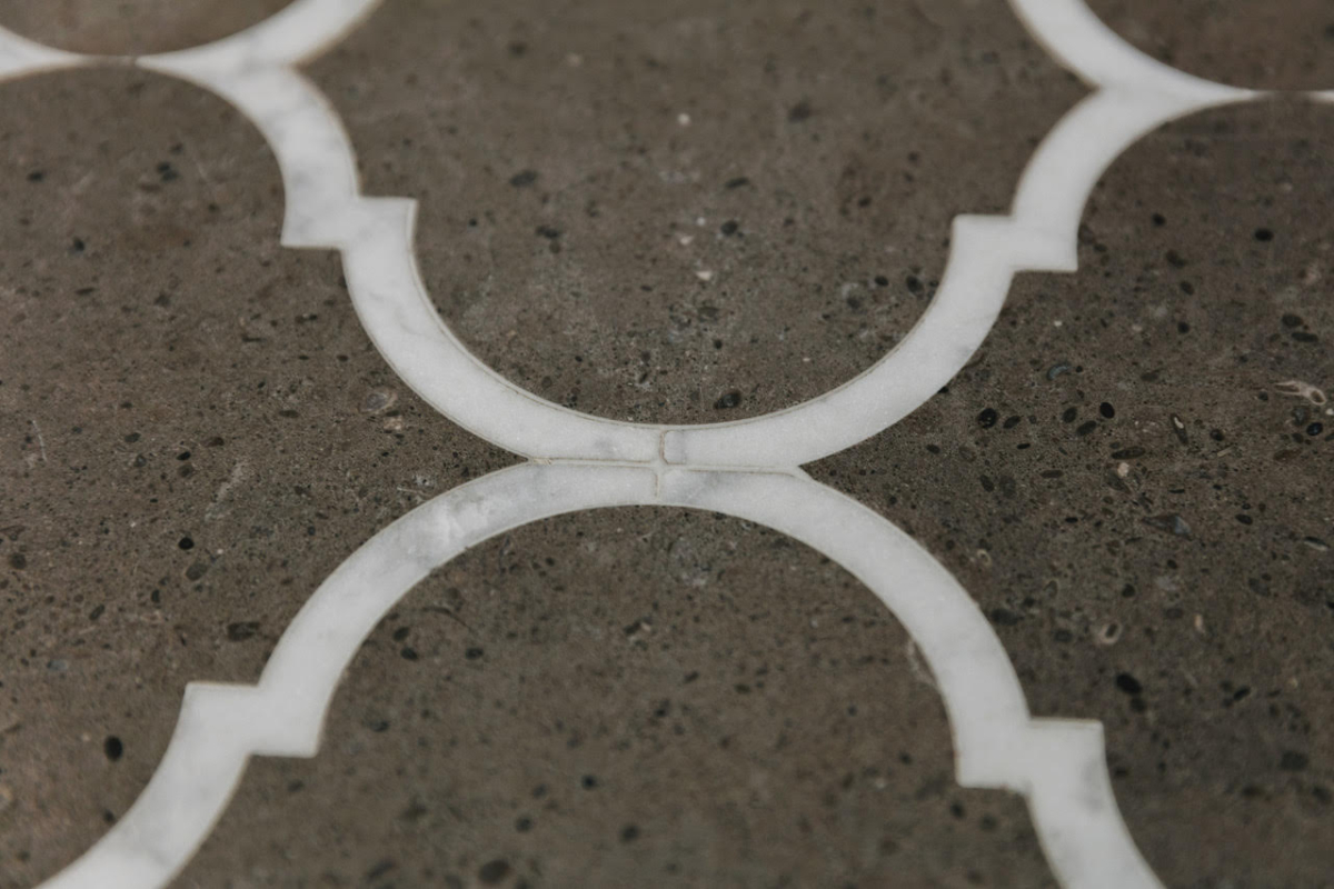 Brazilian Limestone With Calacatta Marble Border Leather Textured Finish Join Close Up Waterject Cut London