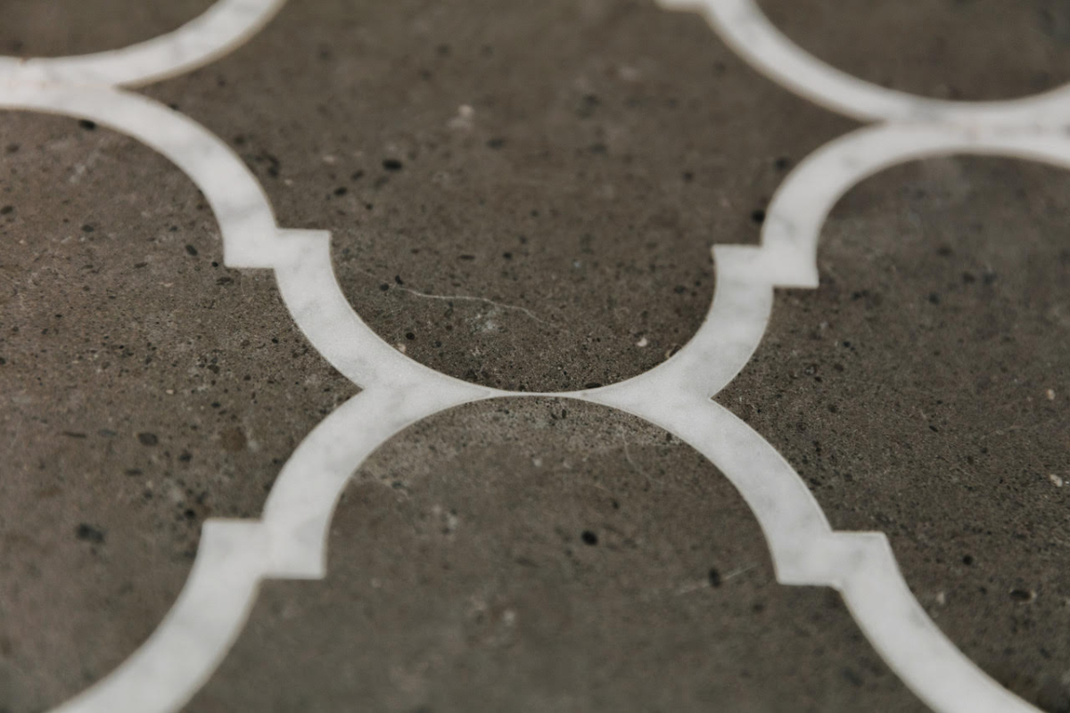 Brazilian Limestone With Calacatta Marble Border Leather Textured Finish Join Close Up Waterjet Cut London 2