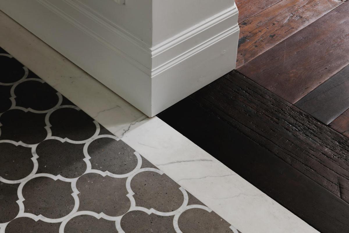 Brazilian Limestone With Calacatta Marble Border Leather Textured Waterjet Cut Meets Wood London