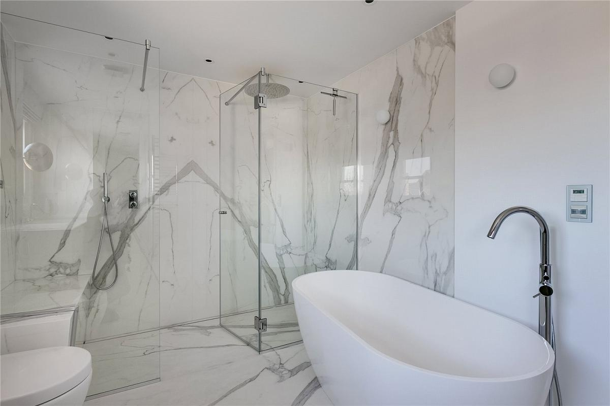 Estatuario Porcelain Slabs Bookmatched Bathroom Walls